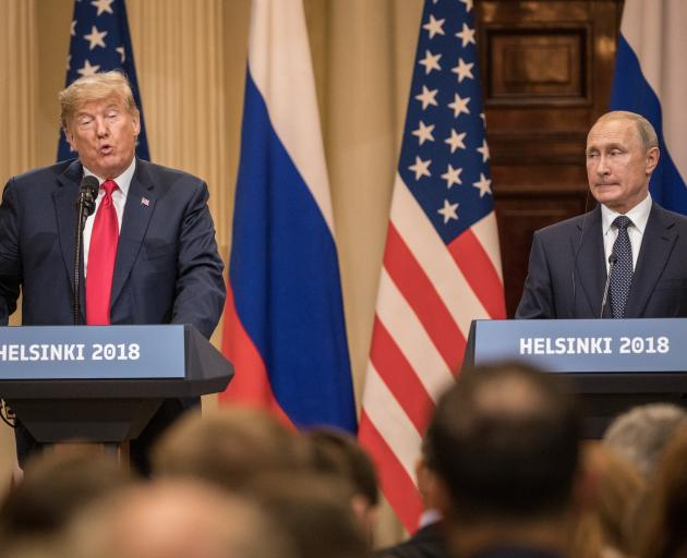 US President Donald Trump speaks during a joint news conference with Russia's President Vladimir...