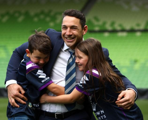 Billy Slater embraces his children, Jake and Tyla Rose, after announcing his retirement at AAMI...