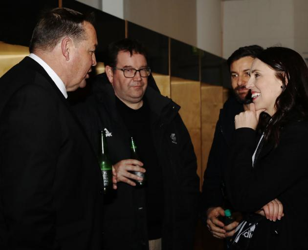 All Blacks coach Steve Hansen (left), with Finance Minister Grant Robertson (centre), Prime...