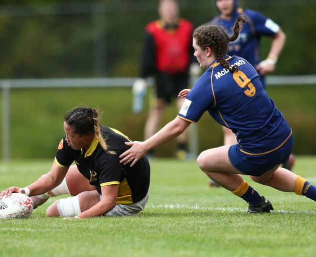 Joanah Ngan-Woo of Wellington scores a try under pressure from Otago's Rosie Buchanan-Brown....