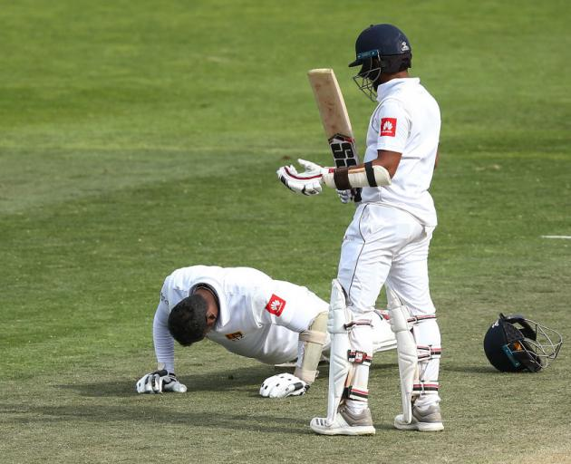 Angelo Mathews celebrates his century with a set of push-ups watched by Kusal Mendis. Photo:...