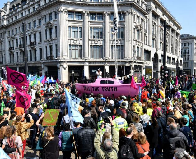 Climate change campaigners co-ordinated by the Extinction Rebellion group block Oxford Circus, in...