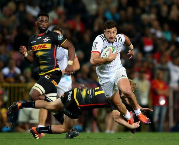 Crusaders player David Havili gets past Justin Phillips of the Stormers at Newlands. Photo: Getty...