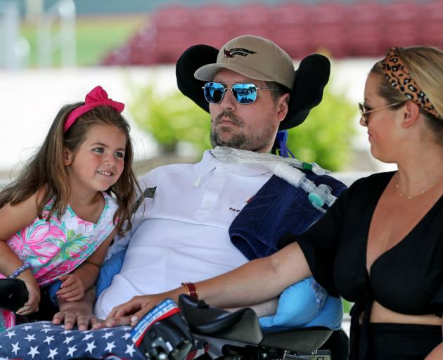 Pete Frates, with daughter Lucy and wife Julie. Photo: Getty Images