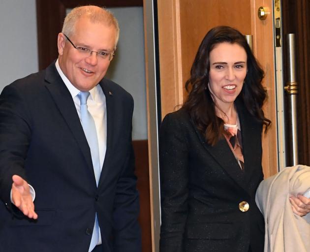 Australian Prime Minister Scott Morrison accompanies New Zealand Prime Minister Jacinda Ardern...