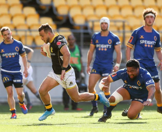 Wellington's Wes Goosen breaks away for one of his three tries at Westpac Stadium on Sunday....