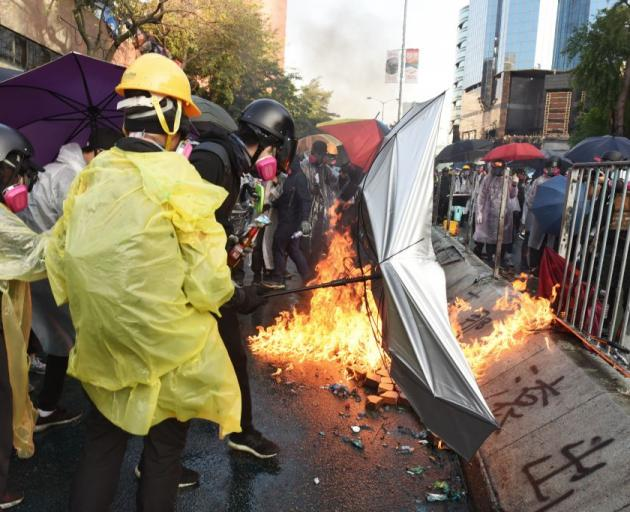 Protesters clash with police during confrontations at the Polytechnic University in Hong Kong on...