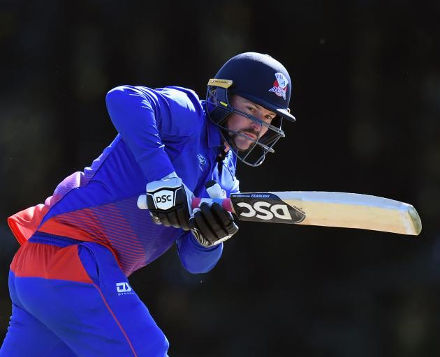 Colin Munro clobbered a quickfire hundred to ease the pressure on Auckland in their chase. Photo:...