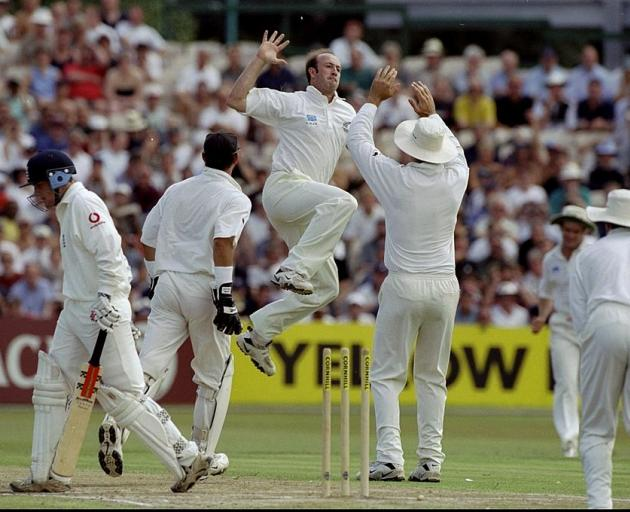 Chris Harris celebrates after bowling England's Chris Read during the third Test match between...