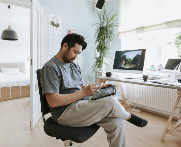 Suits are out and sweatpants in as more people have to work from home due to Covid-19. Photo:...