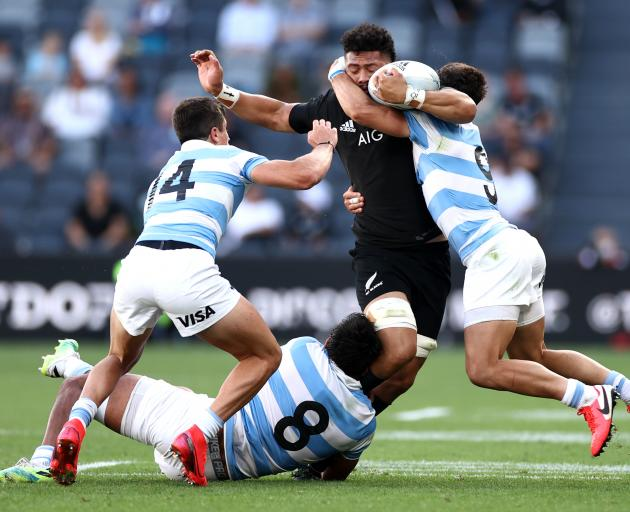 Ardie Savea is enveloped by the Argentine defence. Photo: Getty Images