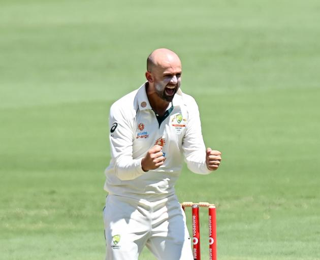 Nathan Lyon celebrates taking the wicket of Indian batsman Shubman Gill during the fourth test at...