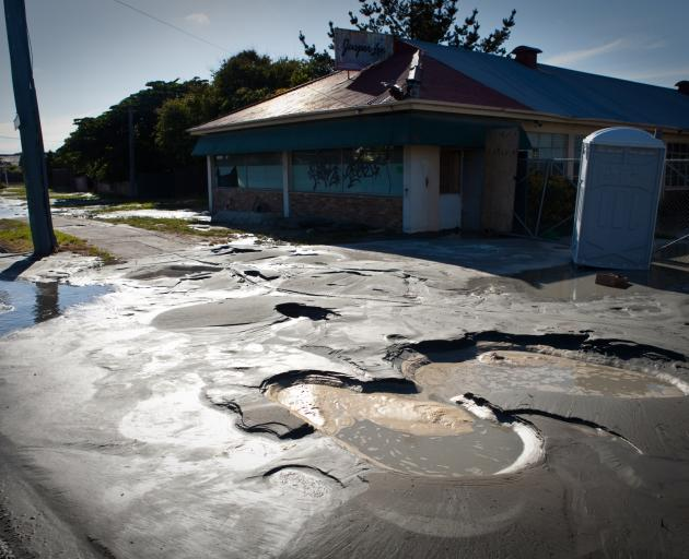 Liquefaction in a Christchurch street following the devastating 2011 quake. Photo: Getty Images