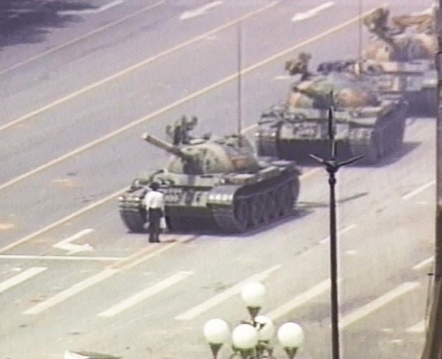 In this famous image, a lone demonstrator stands down a column of tanks at the entrance to...