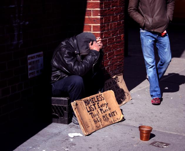 A homeless man begs for money on a New York street. Photo: Getty Images