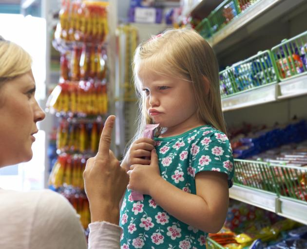 Supermarket tantrums over junk food can make shopping harder work than it needs to be. Photo:...