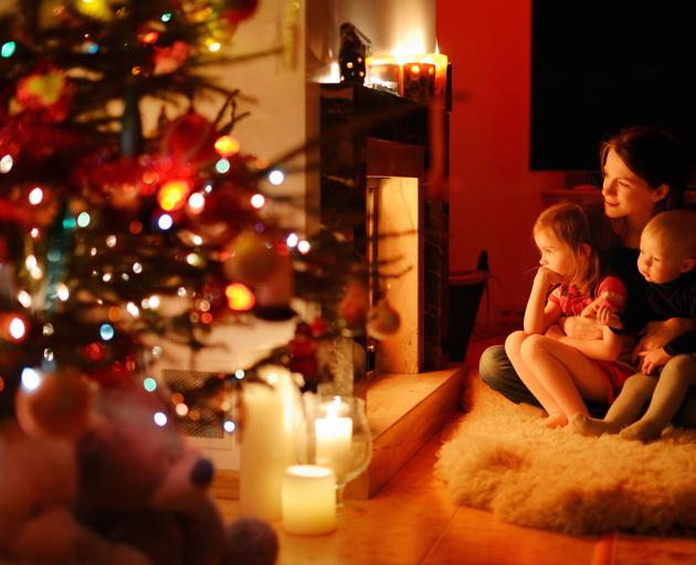Consider ways in which you and your children can share the love, the hope and the goodwill that underlies Christmas. Photo: Getty Images