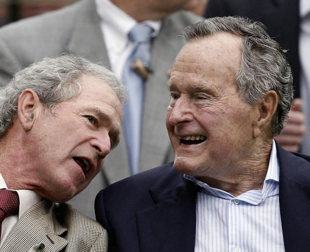 George W Bush (left) with George H.W. Bush. Photo: Getty Images