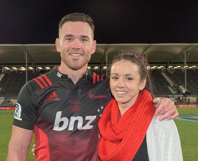 Ryan Crotty with sister Shea at a Crusaders match. Photo: Getty Images