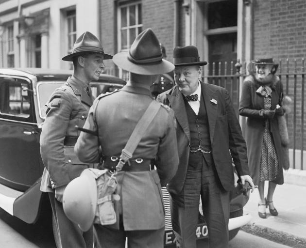 British Prime Minister Winston Churchill chats with two New Zealand soldiers in London in 1940. Photo: Getty Images