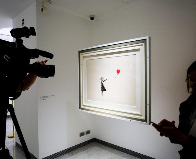 Banksy's Girl and Balloon on show in Rome. Photo: Getty Images