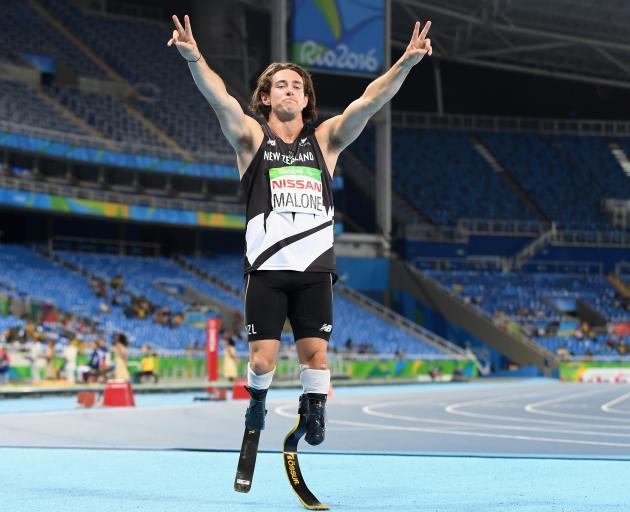 Liam Malone celebrates winning gold in the 200m T44 race at Maracena Stadium. Photo:Getty Images