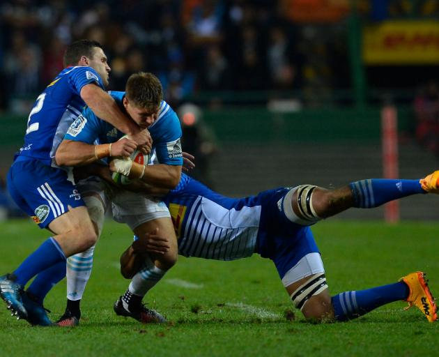 Blues player Piers Francis is tackled by Shaun Treeby and Nizaam Carr. Photo: Getty Images