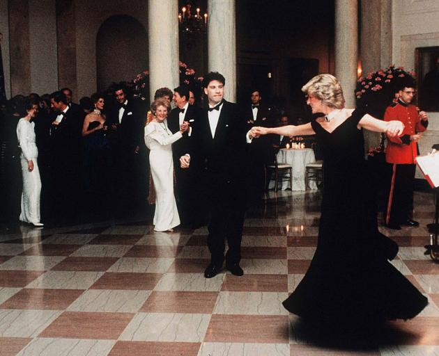Diana, watched by First Lady Nancy Reagan, dances with John Travolta in the Victor Edelstein...