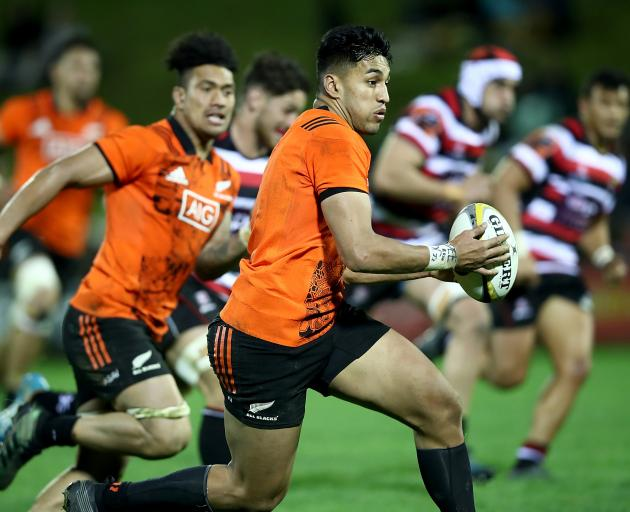 All Black wing Rieko Ioane makes a break against Taranaki during the Game of Three Halves in...