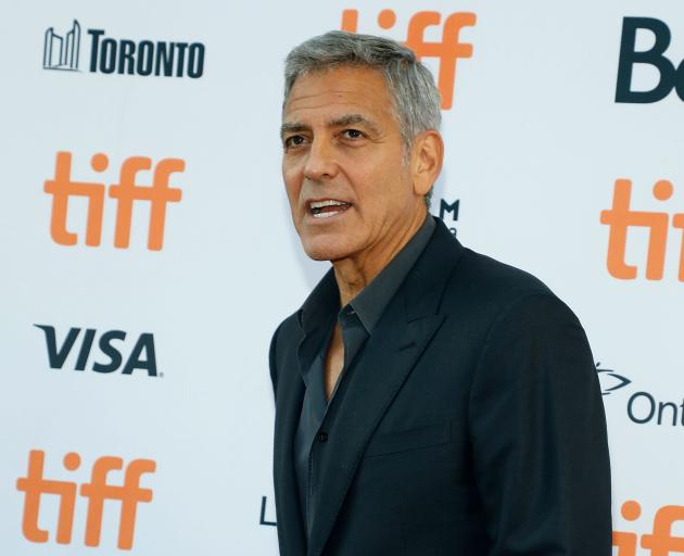 George Clooney's poem follows days of attacks by Donald Trump on NFL players who kneel during the playing of the US national anthem to protest racial disparities in the justice system. Photo: Getty Images