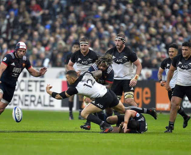 Sonny Bill Williams (centre) drops the ball as he is tackled by Mathieu Bastareau at Stade de...