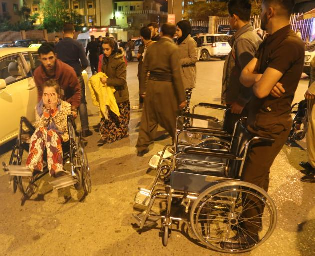 Wounded people arrive to receive treatment at Sulaymaniyah Hospital in northern Iraq. Photo:...