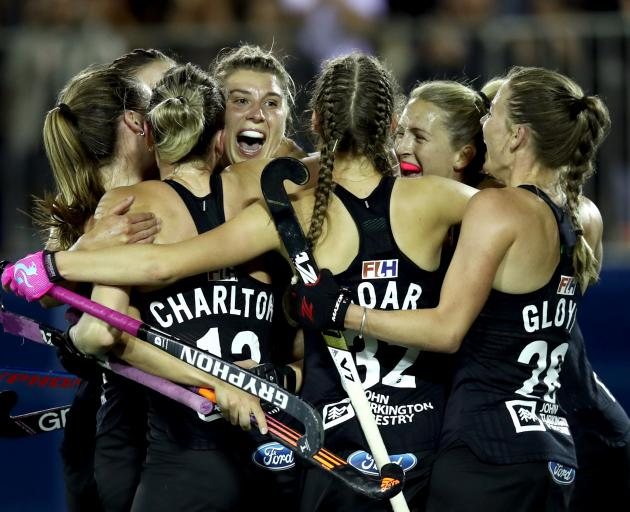 The Black Sticks celebrate after Olivia Merry's (centre) match-winning goal. Photo: Getty Images