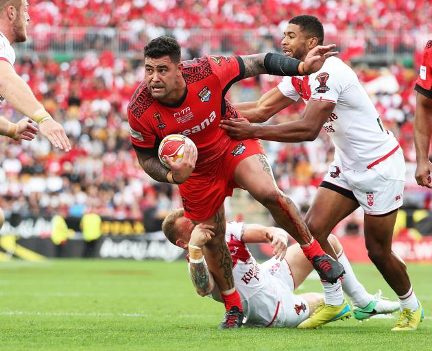 Tonga's Andrew Fifita heads for the tryline last night at Mt Smart Stadium. Photo: Getty Images