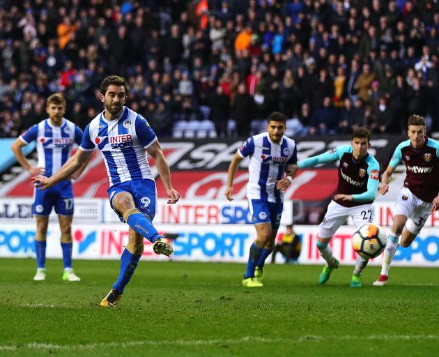 Will Grigg scores Wigan's second goal. Photo: Getty Images