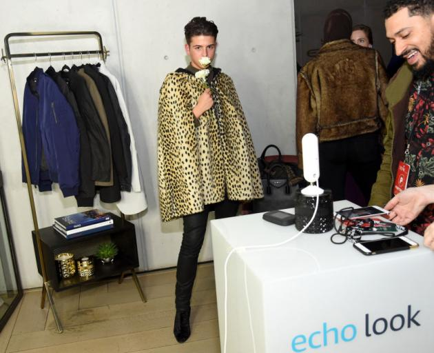 People at New York Fashion Week last year try out Amazon Echo Look. PHOTO: GETTY IMAGES