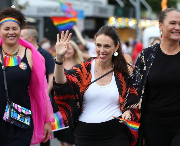 Jacinda Ardern (centre) waves to the crowd lining Ponsonby Rd. Photo: Getty Images