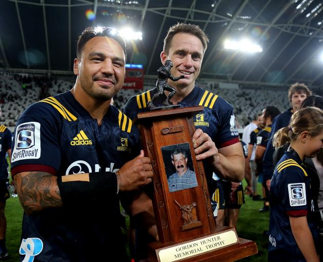 Ash Dixon (left) and Ben Smith of the Highlanders with the Gordon Hunter Memorial Trophy after...