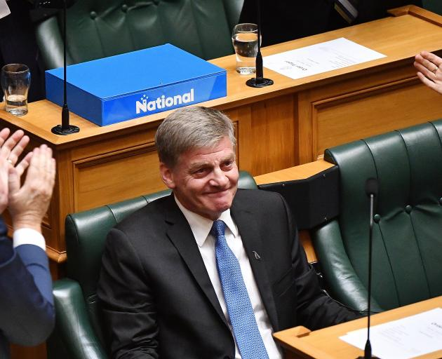 An emptional Bill English is applauded after delivering his valedictory speech in Parliament...