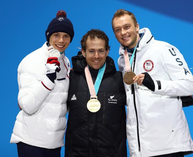 From left: silver medallist Arthur Bauchet of France, gold medallist Adam Hall of New Zealand and...