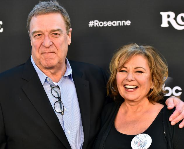 Roseanne Barr with John Goodman, who played her on-screen husband. Photo: Getty Images