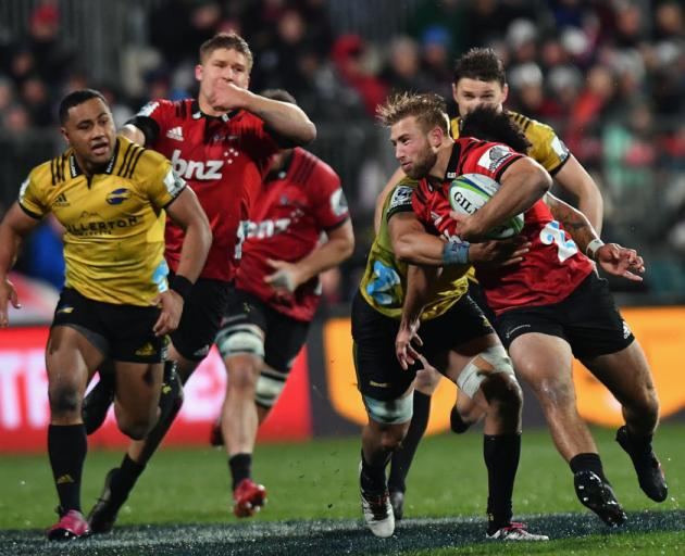 Braydon Ennor is tackled by Ardie Savea in an earlier Super Rugby clash between the Crusaders and...