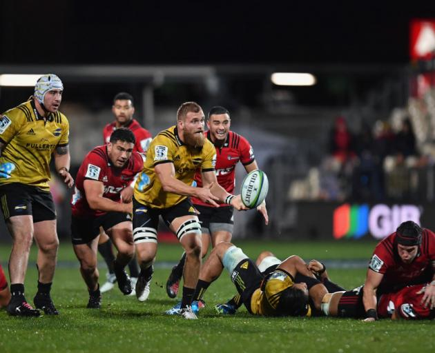 Hurricanes captain Brad Shields clears the ball during an earlier clash with the Crusaders in May...
