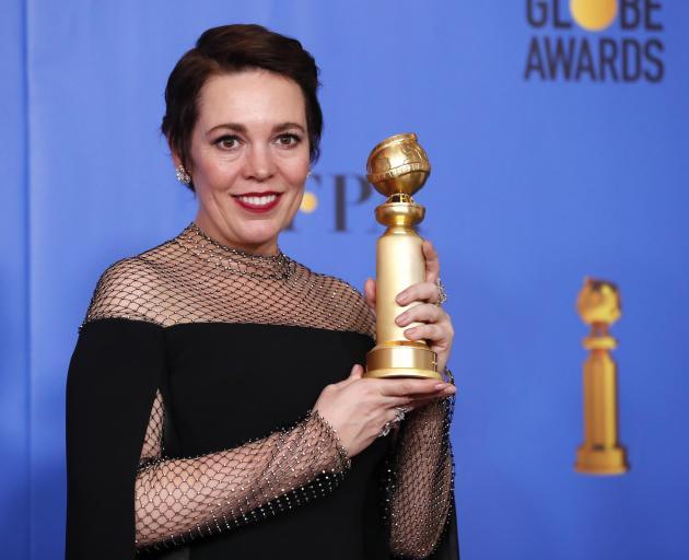 奥利维亚科尔曼在喜剧中以安妮女王的喜剧或音乐剧获得最佳女演员奖。照片:...