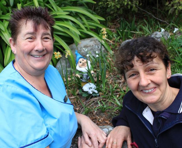 Mercy Hospital linen services co-ordinator Sandra Laidler (left) and hospital gardener Emma Paul...
