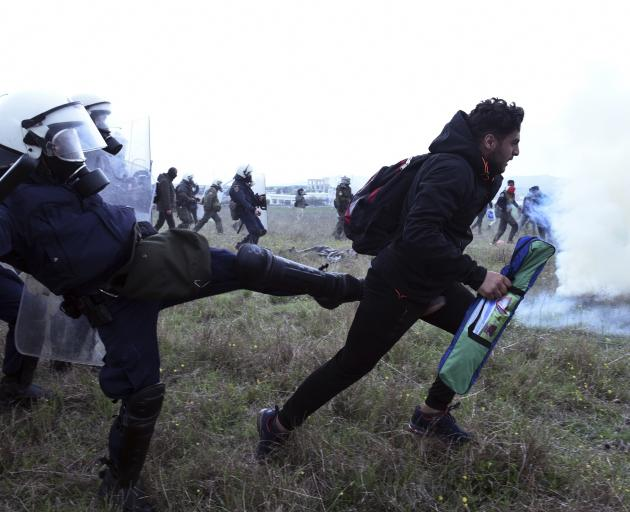 Greek police clash with migrants near North Macedonia border