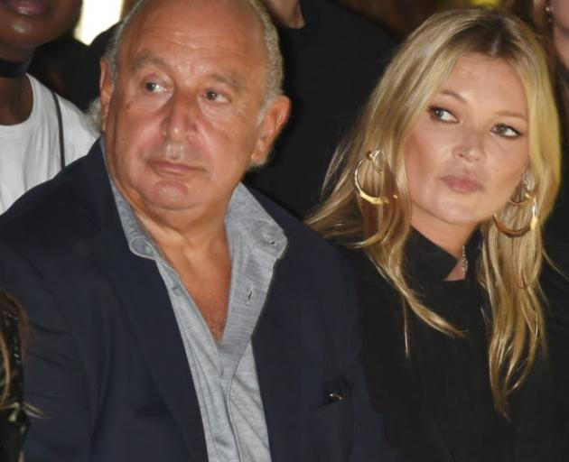 Sir Philip Green and supermodel Kate Moss at Topshop's London Fashion Week show in 2017. Photo:...
