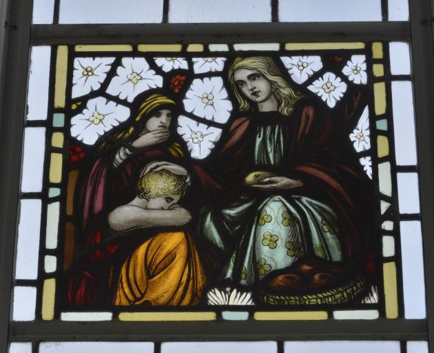 One of the home's  three stained-glass windows. Designer John Brock moved from Melbourne to...