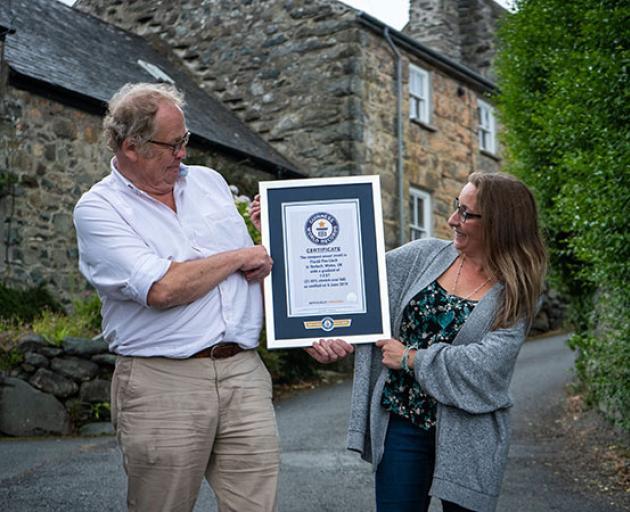 Gwyn Headley and Sarah Badham admire their Guinness World Record certificate stating that Ffordd...
