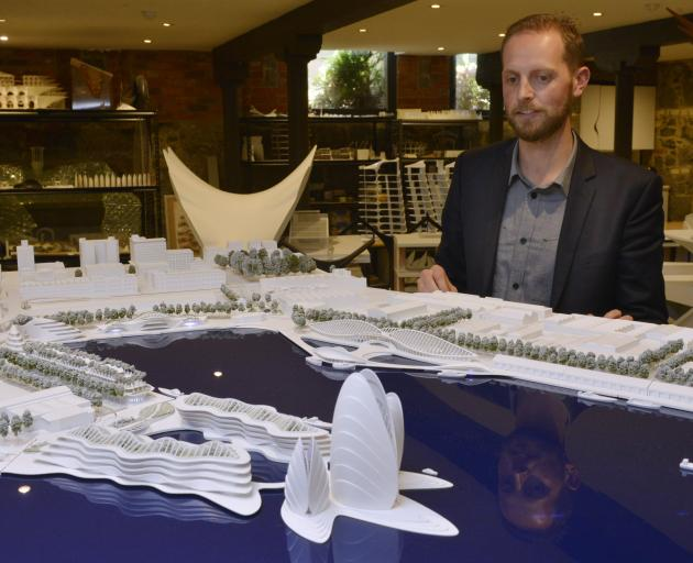 Damien van Brandenburg with a model of his vision for the Otago Harbour Steamer Basin. Photo:...